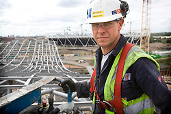 Park staff portrait. Portrait of Kevin Lumley, a steel fabricator working from a cherry picker on the Aquatics Centre roof. Picture taken on 08 August 09 by David Poultney.
