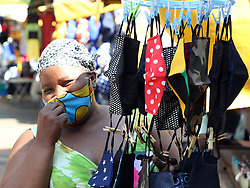 South Africa - Durban - 15 October 2020 - Coronavirus - Patricia Mdingi selling a variety of masks from basic to bling at the Workshop market area in Durban.South Africa remains on level one eventhough the infection rate has gone down. We are not in the clear just yet,so it is important to keep wearing mask and practicing social distancing.<br /> Picture: Shelley Kjonstad/African News Agency(ANA)