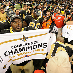 Jan 24, 2010; New Orleans, LA, USA; New Orleans Saints defensive tackle Sedrick Ellis (98) holds up a conference champions towel following a victory over the Minnesota Vikings in overtime of the 2010 NFC Championship game at the Louisiana Superdome. Mandatory Credit: Derick E. Hingle-US PRESSWIRE