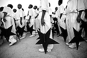 Children hold cardboard black stars as they prepare to perform during celebrations held at the Independence Square in Accra, Ghana, on Tuesday Mar 6, 2007. Celebrations were held here and elsewhere in the country on the occasion of Ghana's 50th anniversary of independence from Britain.