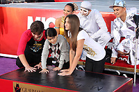 1/26/2012 Prince, Blanket & Paris Jackson at Michael Jackson's posthumous hand/ footprint ceremony at Grauman's Chinese Theater