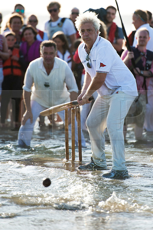 © London News Pictures. 22/08/2013. Southampton, UK.  Teams play a cricket match on the Bramble Bank in the middle of The Solent on August 22, 2013.  The annual cricket match between the Royal Southern Yacht Club and The Island Sailing Club, takes place on a sandbank which appears for 30 minutes at lowest tide. The game lasts until the tide returns. Photo credit : Ben Cawthra/LNP