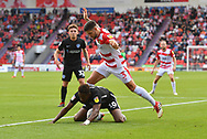 Doncaster Rovers defender Danny Andrew (3) and Portsmouth FC midfielder Jamal Lowe (10) during the EFL Sky Bet League 1 match between Doncaster Rovers and Portsmouth at the Keepmoat Stadium, Doncaster, England on 25 August 2018.Photo by Ian Lyall.
