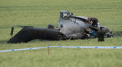 © licensed to London News Pictures. Andover, UK  05/07/11. Military personnel attend the scene. A British RAF Puma helicopter pilot and two crew members escaped without serious injury today after crash-landing in a field. Police said the crewmen were able to walk away unharmed after the Puma helicopter came down close to the A303, near the Walworth industrial estate in Andover, Hampshire.. Photo credit should read Ian Forsyth/LNP