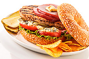 Turkey sausage patty sandwich on sesame bagel,with blue cheese,tomato,lettuce,cranberries,dill pickles