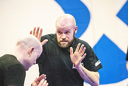 Andy taping heads each other during one of the exercises. Stef Noij, KMG Instructor from the Institute Krav Maga Netherlands, the IKMS G Level Programme seminar today at the Scottish Martial Arts Centre, Alloa.