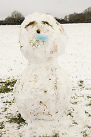 snowman with mask on Stratton Audley Oxfordshire photo by Brian Jordan 24th jan 2021