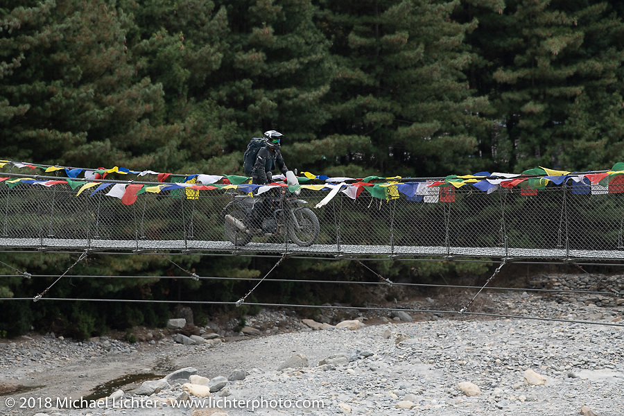 Sean Lichter riding a suspension bridge on day-6 of our Himalayan Heroes adventure riding from Muktinath to Tatopani, Nepal. Sunday, November 11, 2018. Photography ©2018 Michael Lichter.