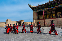 A mock army like one that would have once occupied the fort. Jiayuguan Fort is the western end of the Great Wall built in the Ming Dynasty (1368 – 1644). It was an important military fortress and  key waypoint of the ancient Silk Road. This was the last major stronghold of Imperial China. Gansu Province, China.
