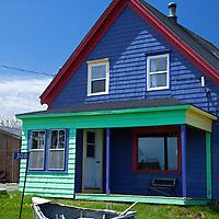 North America, Canada, Nova Scotia, Guysborough County. A colorful house adds character to the landscape of Nova Scotia.