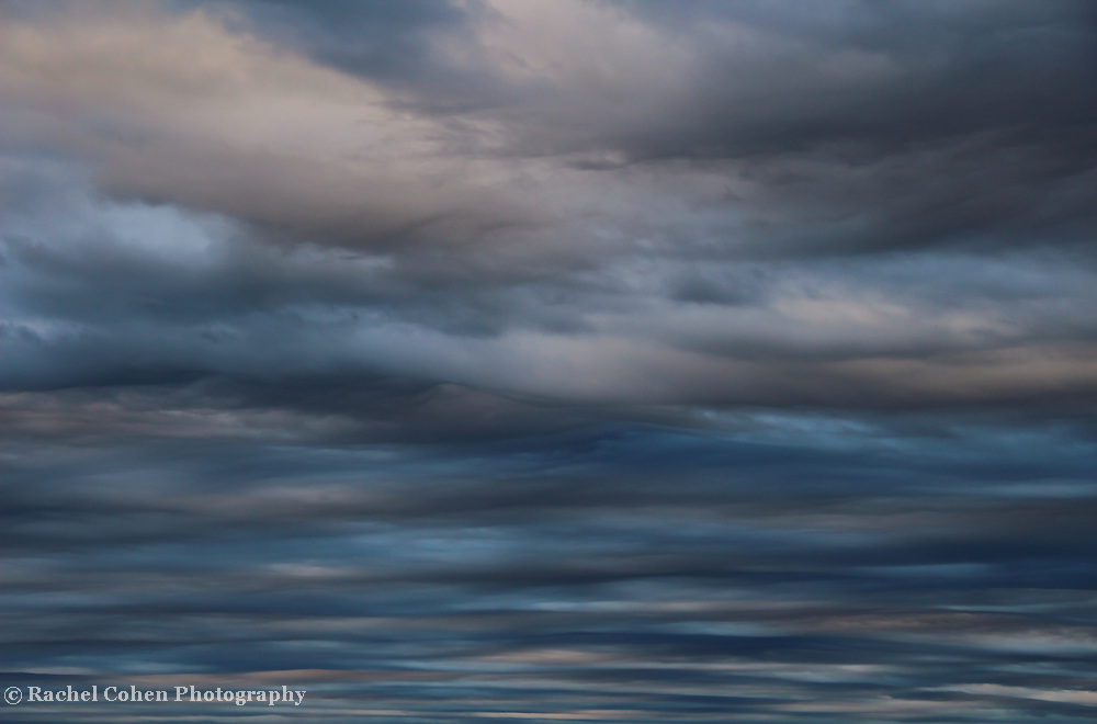 """""""Turbulence""""<br /> <br /> A beautiful and turbulent image. Layer upon layer of alternating blues, and grays, ending on top with looming dark storminess!!<br /> <br /> Nature Abstracts by Rachel Cohen"""
