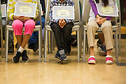 Contestants' feet can barely touch the ground as they wait to spell during the 2016 Milpitas Youth Spelling Bee at the Milpitas Senior Center in Milpitas, California, on January 22, 2016. (Stan Olszewski/SOSKIphoto)