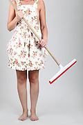 Housewife cleaning the house with a mop. Model released