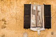 Mesquito netting covers a window on a home in Lavento near Lago Maggiore.