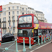 UK weather: Red City Tour bus at Brighton Pier in UK on July 27 2018.