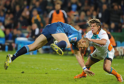 PRETORIA, South Africa, 28 May 2011. Jaco Pretorius of the Bulls is tackled by Riaan Smit of the Cheetahs during the Super15 Rugby match between the Bulls and the Cheetahs at Loftus Versfeld in Pretoria, South Africa on 28 May 2011..Photographer : Anton de Villiers / SPORTZPICS