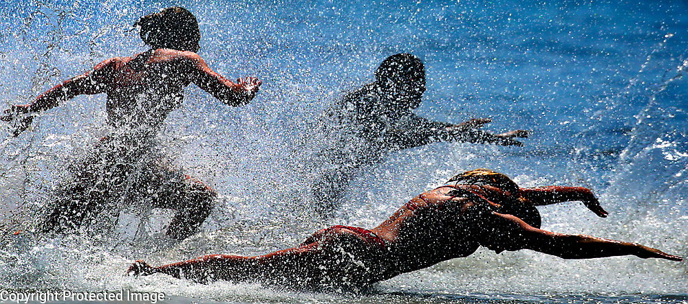Junior Guards hit the water during the surf balls event at a regional Junior Lifeguard competition at Main Beach in Santa Cruz, California during a regional meet hosted by Seacliff State Beach guards.<br /> Photo by Shmuel Thaler <br /> shmuel_thaler@yahoo.com www.shmuelthaler.com