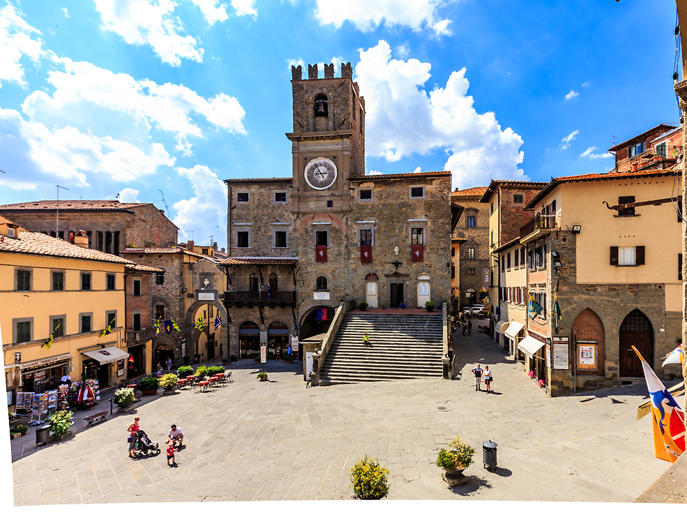 The Palazzo Comunale in Cortona, Italy. Cortona's historical centre comprises Palazzo Comunale (1241) with its flight of steps leading up to the entrance and an embattled tower, Palazzo del Capitano del Popolo (1250) and Palazzo Pretorio (1268)