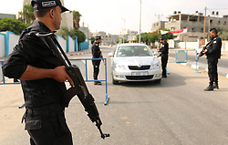 August 17, 2017 - Rafah, Gaza Strip, Palestinian Territory - Palestinian policemen stop a vehicle at a security checkpoint, in Rafah in the southern of Gaza Strip August 17, 2017. A suicide bomber killed a Palestinian security man in southern Gaza, officials said, in what was seen as a rare Islamist attack against the Palestinian group that has run the impoverished enclave for a decade  (Credit Image: © Ashraf Amra/APA Images via ZUMA Wire)