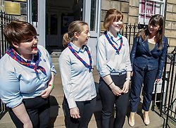 Pictured: Girlguides,  Katie Young, Hannah Brisbane and Katier Horsburgh welcomed the minister toi the GirlGuides Edinburgh Office<br />