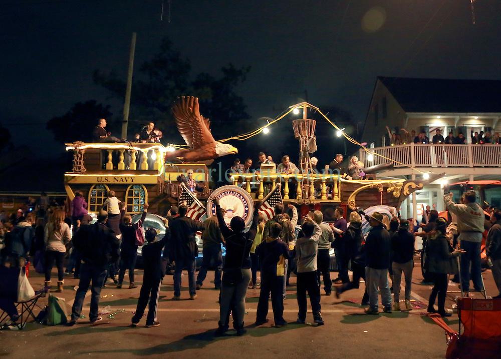 28 Feb 2014. New Orleans, Louisiana.<br /> Mardi Gras. The Krewe D'Etat rolls along Magazine Street through Uptown New orleans. <br /> Photo; Charlie Varley/varleypix.com