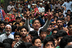 June 17, 2017 - Pampore, Jammu and Kashmir, India - Thousands of people on Saturday participated in the funeral prayers of slain Lashkar-e-Toiba Febel Adil Mushtaq Mir in Frestbal area of Pampore in south Kashmir's Pulwama district.The funeral prayers were held at a local ground where mourners braving heat and fasting continued to pour in from various parts of south Kashmir. (Credit Image: © Umer Asif/Pacific Press via ZUMA Wire)