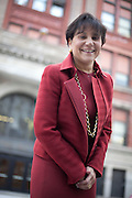 Penny Pritzker stands in front of the Talcott Fine Arts and Museum Academy.