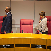 Mayor Pro Tem Barnes and Councilwoman Lyles turn to face the flag during the Pledge Of Allegiance during a special city council meeting to discuss appointing a new mayor.