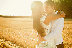 Smiling Couple Hugging in a Field
