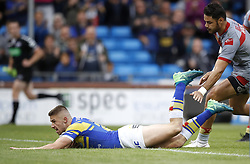 Leeds Rhinos Jack Walker goes over for a try past Catalans Dragons' Brayden Wiliame, during the Betfred Super League match at Emerald Headingley Stadium, Leeds.