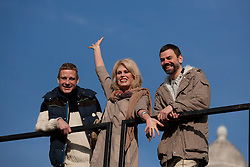 © Licensed to London News Pictures. 23/02/2012. LONDON, UK. Actress Joanna Lumley waves  as she stands between artists Micheal Elmgreen (L) and Ingar Dragset (R) after unveiling Trafalgar Square's newest addition. Unveiled by actress Joanna Lumey today (23/02/12) in Trafalgar Square, Elmgreen and Dragset's 'Powerless Structures, Fig. 101' replaces the previous sculpture of a ship in a bottle on the famous Fourth Plinth. Photo credit: Matt Cetti-Roberts/LNP