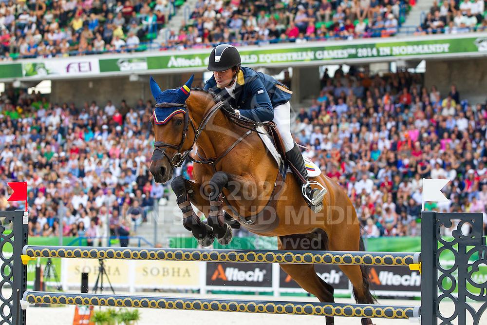 Roberto Teran Tafur, (COL), Woklahoma - World Champions, - Second Round Team Competition - Alltech FEI World Equestrian Games™ 2014 - Normandy, France.<br /> © Hippo Foto Team - Leanjo De Koster<br /> 25/06/14
