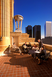 Stock photo of a group of business professionals taking a break on a high rise patio