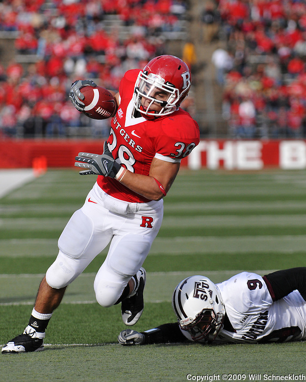 Oct 10, 2009; Piscataway, NJ, USA; Rutgers running back Joe Martinek (38) avoids Texas Southern defensive back Curtis Thomas (9) on his way into the end zone during first half NCAA college football action between Rutgers and Texas Southern at Rutgers Stadium.