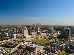 Aerial view of the Texas Medical Center with the downtown Houston skyline on the horizon.