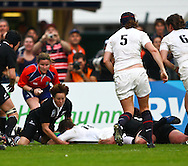 5th September 2010, Twickenham Stoop, London, England: Charlotte Barras of England scores England's only try during the IRB Women's Rugby World Cup final between England and New Zealand Black Ferns. New Zealand won 13-10, capturing the trophy for the 4th time.  (Photo by Andrew Tobin www.slikimages.com)
