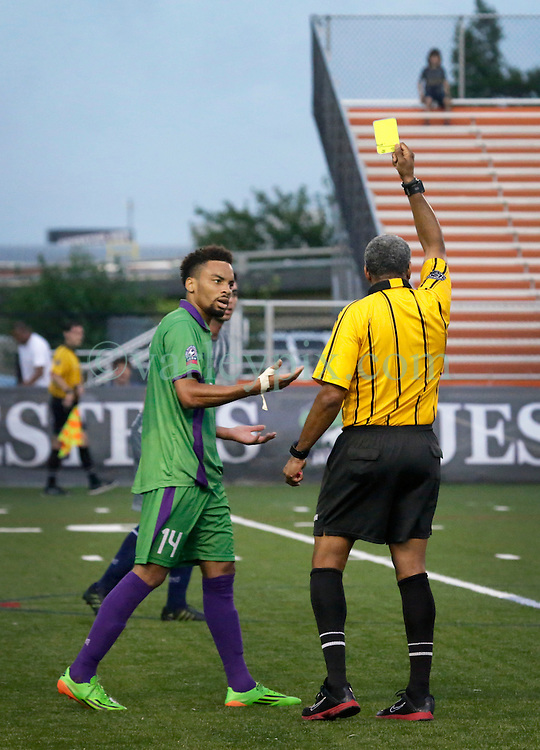 16 May 2015. New Orleans, Louisiana.<br /> National Premier Soccer League. NPSL. <br /> 1st half. The New Orleans Jesters play Nashville FC at home in the Pan American Stadium. Second of the yellow cards. Jesters drew 1-1 with Nashville in a game that ended in a controversial equalizer from a free kick awarded to Nashville as the minutes wound down in extra time.<br /> Photo; Charlie Varley/varleypix.com
