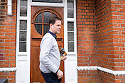 © Licensed to London News Pictures. 26/04/2015. Sutton, UK  NICK CLEGG leaflets Orchard Road in Sutton. Deputy Prime Minister and Leader of the Liberal Democrats Nick Clegg makes a speech today, 26th April 215 in Sutton, to local Liberal Democrats in support of the candidate for Sutton and Cheam, Paul Burstow. Nick Clegg and Paul Burstow also joined local campaigners to deliver leaflets on a nearby street, and put up a Liberal Democrat stakeboard.. Photo credit : Stephen Simpson/LNP