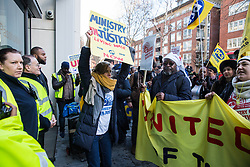 London, UK. 22nd January, 2019. Members of the United Voices of the World (UVW) trade union representing receptionists, security guards and cleaners at the Ministry of Justice (MoJ) stand outside the entrance of the Home Office after beginning a coordinated strike for the London Living Wage of £10.55 per hour and parity of sick pay and annual leave allowance with civil servants. The strike is being coordinated with support staff at the Department for Business, Energy and Industrial Strategy (BEIS) from the Public and Commercial Services (PCS) union.