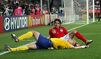 Photo: Chris Ratcliffe.<br /> Sweden v England. FIFA World Cup 2006. 20/06/2006.<br /> Christian Wilhelmsson of Sweden clashes with Owen Hargreaves of England.