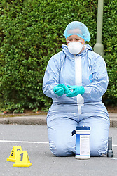 © Licensed to London News Pictures. 19/06/2019. London, UK. A forensic officer next to the evidence markers on Wellbeck Road, Barnet, North London  where three men were found to be suffering stab injuries on Tuesday 18 June 2019, just before 11pm. A man in his 30s was treated at the scene, but he was pronounced dead shortly after midnight. Two other men – one in his 20s and one in his 30s were taken to hospital for treatment.  Photo credit: Dinendra Haria/LNP