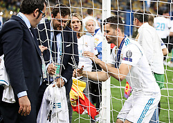Real Madrid's Spanish defender Nacho Fernandez cuts the goal net after winning the UEFA Champions League final football match between Liverpool and Real Madrid at the Olympic Stadium in Kiev, Ukraine, on May 26, 2018. Photo by Andriy Yurchak / Sportida