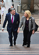 © Licensed to London News Pictures. 03/06/2013. London, UK Ed Balls MP (L) arrives at Canary Wharf Tube station with Barbara Keeley MP. Labour's Shadow Chancellor, makes a speech on the UK economy at Reuters,  this Monday 3 June.. Photo credit : Stephen Simpson/LNP