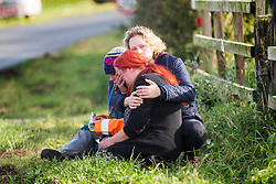 © Licensed to London News Pictures. 10/10/2017. Kirby Misperton UK. Anti fracking campaigners console each other as the drilling rig arrived at the Kirby Misperton KM8 fracking site this morning despite 22 days of protests & daily attempts to block access to the Kirby Misperton fracking site by anti fracking campaigners. Third Energy was granted planning permission last year to frack the site but has not yet received final consent to begin fracking, but expects to start before the end of the year. Photo credit: Andrew McCaren/LNP
