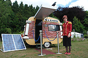 23/11/2010- South Wales<br /> This is world's smallest Solar Powered Cinema, built on a converted caravan by a charity called Undercurrents, The Sol Cinema is a micro movie house powered entirely by the Sun. We can accommodate 8 adults comfortably for a unique cinematic experience. We have a full library of comedy, quirky, music videos and short films with inspiring environment themes. We are a non-profit project from the award winning charity, Undercurrents. The Sol Cinema has been lavished with pride and style. We use an LED projector showing short movies in cinematic surroundings. We use lithium batteries to store the energy from the Sun to power the cinema all day and night. Our photovoltaic panels harness the sunlight, even as the films are being shown, so we never run out of power.<br /> recycled from 1960's two berth caravan to produce the Sol Cinema. What makes it possible to operate such a compact cinema is our Lithium ion batteries. These are usually used in electric cars but they are ideal for our work. Our 120W solar panels receive Sunlight to charge our batteries ensuring that we always have power, whatever the weather.<br /> ©Paul O'Connor/Exclusivepix