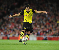 Borrusia Dortmund's Sokratis Papastathopoulos shoots outside the box but fails to score.- Photo mandatory by-line: Alex James/JMP - Tel: Mobile: 07966 386802 22/10/2013 - SPORT - FOOTBALL - Emirates Stadium - London - Arsenal v Borussia Dortmund - CHAMPIONS LEAGUE - GROUP F