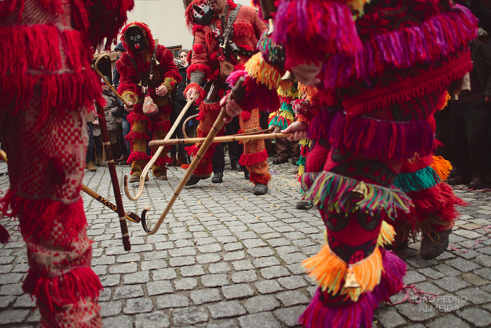 Caretos from Trás-Os-Montes, some of the invited groups at Lazarim, doing tricks to the crowd watching the parade.