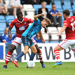21/7/2018 - Henry Cowans of AFC Telford holds off Mark Carrington and Akil Wright during the pre season friendly fixture between AFC Telford United and Wrexham at the New Bucks Head Stadium, Telford.<br /> <br /> Pic: Mike Sheridan/Newsquest NW<br /> MS173-2018