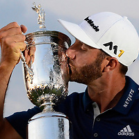 Dustin Johnson  kisses the Championship Trophy on the 18th green after winning his first major championship in the final round at the U.S. Open at Oakmont Country Club near Pittsburgh, Pennsylvania on June 19, 2016. Johnson won with a score of 5 under par. Photo by Archie Carpenter/UPI