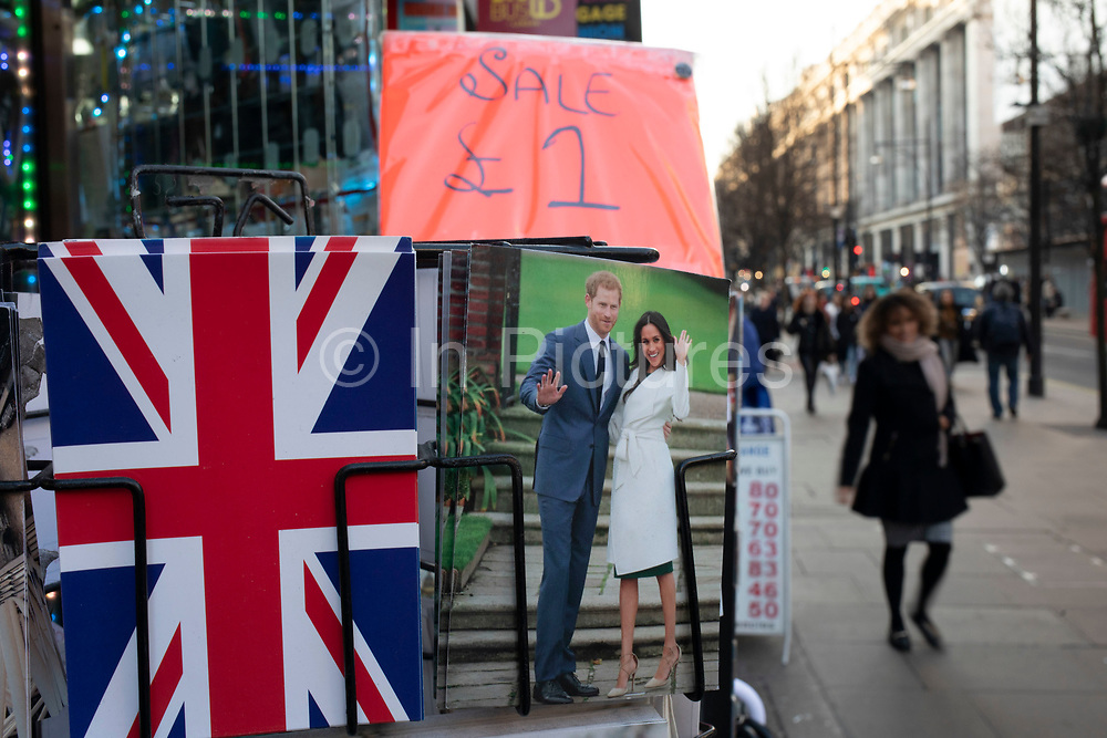 Harry and Meghan postcards for sale next to a Union Jack flag card as if they are waving goodbye to the UK on a rack on 21st January 2020 in London, England, United Kingdom. Earlier it had been reported that after recent controversy and discussion amongst members of the royal family, that Prince Harry had flown out of the UK to be with his wife Meghan and their family. Prince Harry and Markle announced recently that they will step back from their roles as senior royals to share their time between the UK and Canada, and to continue both their charity work and continue to a degree their royal responsibilities.
